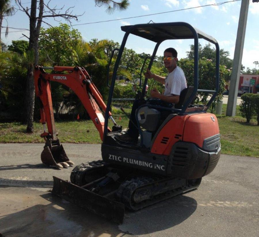 Aztec Plumbing & Drains backhoe